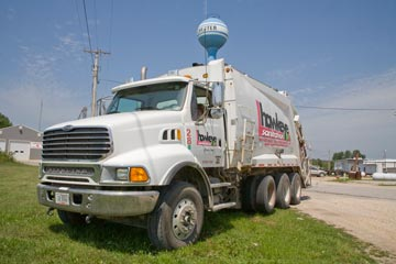 Big Garbage Truck in front of the Chester water tower.